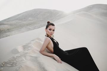 Professional photo shoot of beautiful sexy asian woman on a dune of desert