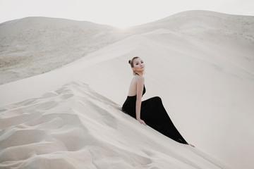 Fashion photo shoot of beautiful sexy asian woman in desert