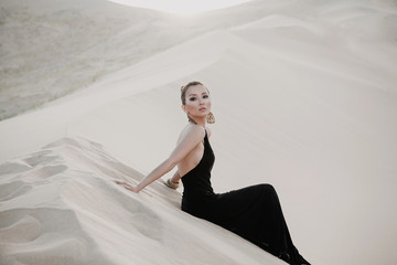 Fashion photo of beautiful sexy asian woman in desert