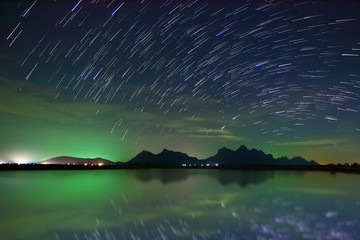 Beautiful scenery of the startrail on night sky at Khao Sam Roi Yot National Park,Prachuap Khiri Khan Province in Thailand. Long exposure shooting and high iso used make this photo have noise.