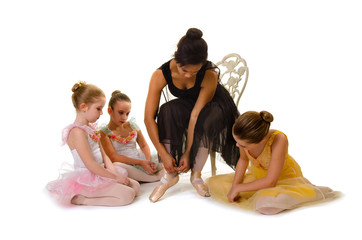 Young Ballet Dancers Learn to Tie Pointe Shoes from African American Ballerina