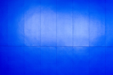 The dark blue concrete wall with the light