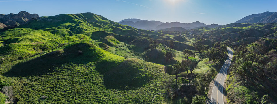Small road in the hills and green trees of southern California Los Angeles County.