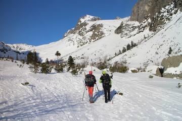 Trekkers in Veľka Studená valley in High Tatras, Slovakia