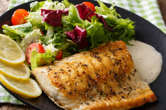 Tasty roasted fish fillet Arctic char and fresh vegetables close-up. horizontal