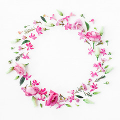 Flowers composition. Wreath made of various pink flowers on white background. Flat lay, top view