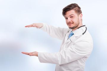 Handsome medic holding something between hands