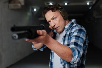 Nice confident man preparing to shoot