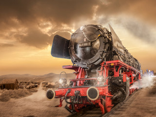 Steam locomotive drives through the desert