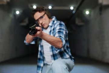 Serious skilled marksman shooting at you