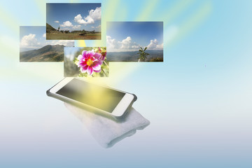 mobile on handkerchief and light effect show place of travel and flower