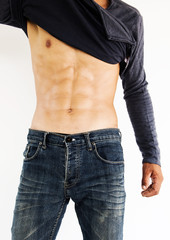 Muscular male model showing his abs,Healthy lifestyle concept and ideas