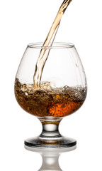 Fototapete - Brandy or whiskey is poured into a glass