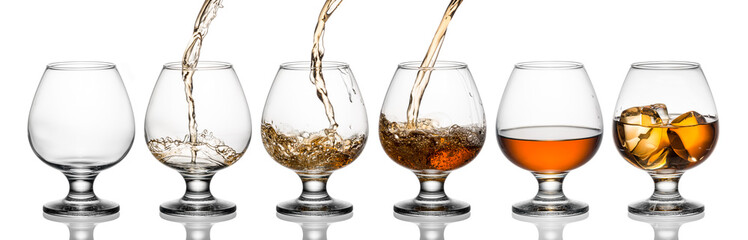 Wall Mural - Glasses with whiskey or brandy isolated on white background