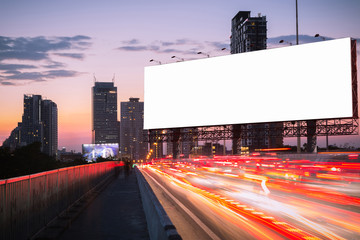 traffic jame in the twilight with blank billboard.