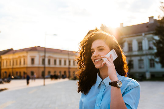 Portrait of a woman talking on the cell phone in a crowded street