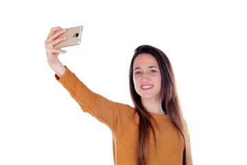 Teenager girl taking a selfie with her mobile