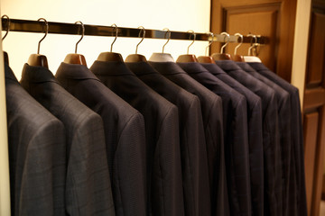 Photo of rack with suits