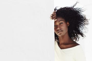 Beautiful model on white wall, portrait