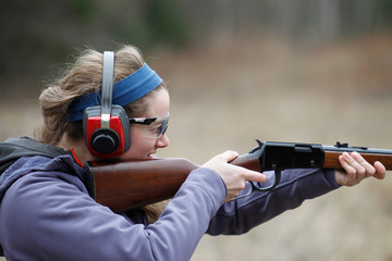 Close-up of girl shooting a rifle
