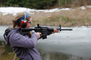 Woman shooting a modern sporting rifle