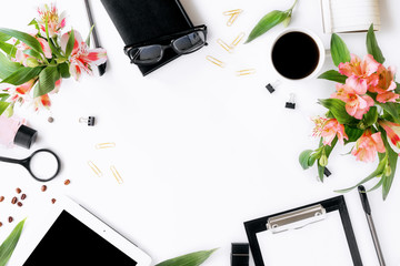 Frame of tablet, clipboard, office accessories, coffee and flowers