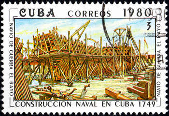 UKRAINE - CIRCA 2017: A postage stamp printed in Cuba shows shipyard from series Constructing of ships on Cuba, circa 1980