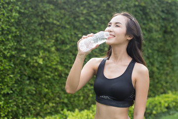 Portrait of attractive smiling young asian woman with fresh water, Healthcare, Drinks. Health, Beauty, Diet, Healthy eating, Healthy lifestyle concept.