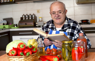 elderly man cooking a healthy meal