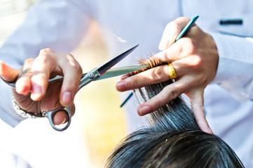 Hair cut at a hairdresser salon.