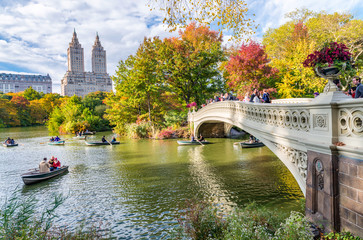 NEW YORK CITY - OCTOBER 2015: Tourists in Central Park enjoy foliage season. The city attracts 50 million people annually