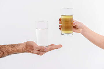 Persons holding glassfuls of liquid