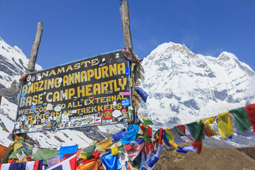 ANNAPURNA, NEPAL – APRIL 14, 2016 : Himalaya Annapurna South mountain peak with Annapurna base camp sign, there is very famous trekking destination in Nepal.
