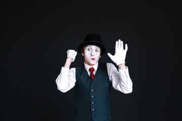 Mime knocks in invisible door