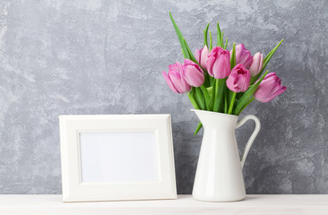 Fresh pink tulips bouquet and photo frame