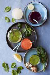 Freshly pressed carrot, kale spinach, berry and lemon ginger juice