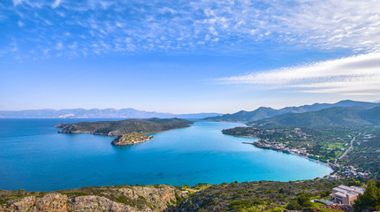 "Panoramic view of the gulf of Elounda with the island of Spinalonga. Here were isolated lepers, humans with the Hansen's desease and took place the story of Victoria 's Hislop novel ""The Island""."
