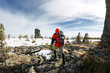 Winter Hiking in the mountains with a backpack and snowshoes