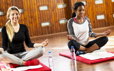 Cute girls on a yoga class. 