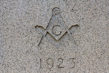Traditional masonic symbol on marble wall