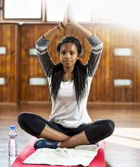 Cute young girl in a yoga pose.