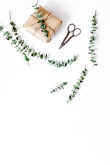 present design in box with flowers on white background top view mockup