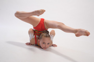 Young girl doing gymnastics