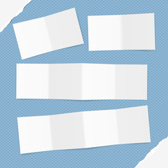 Folded white letter, brochure, leaflet with shadow on blue squared pattern and ripped paper in corners