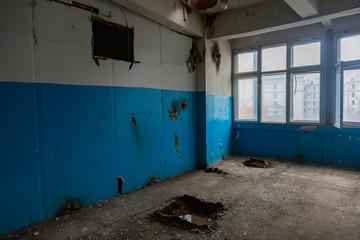 Inside an abandoned deserted cluttered industrial building