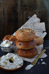 Assorted Bagels on rustic table with music sheets