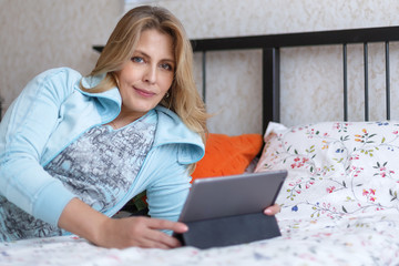 Blonde woman with computer indoor
