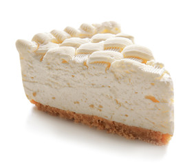 Fototapete - Piece of delicious cheesecake on white background
