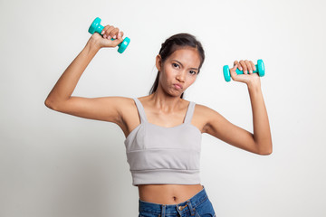 Exhausted Asian woman with dumbbells.