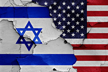 flags of Israel and USA painted on cracked wall